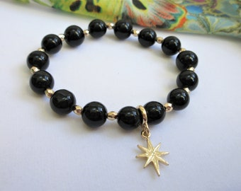 Genuine Black Onyx stretch bead bracelet, 15 10mm beads, w/faceted gold beads spacers, and one 2 sided star charm, Highly polished, 7.5 size