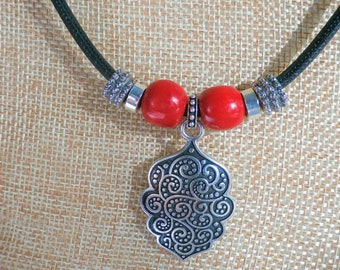Sterling Silver medallion pendant necklace, 2 sided s.silver medallion,red wood beads, lobster claw closure on 22 inch on black cork, unisex
