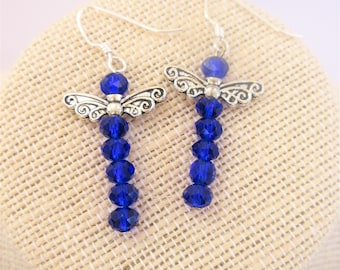 Blue cut crystal ball beads, Dragonfly earrings with 2 sided 925 sterling silver wings and excellent sterling ear wires. Hand wired.