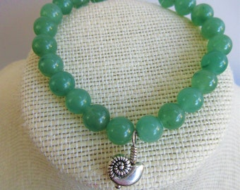 Green Jade Bracelet,21 8mm bead wired bracelet with 925 silver clasp, hand wire wrapped 925 plated nautilus drop, 7 inches long, Perfection.
