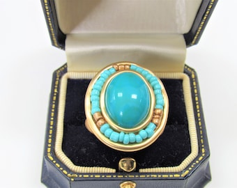 Large oval Turquoise stone ring,gold sculpted setting,surrounded by gold /blue seed beads,Size 8, set with signature crystal inside the band