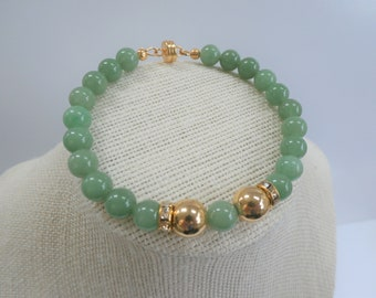 "Aventurine green bead bracelet, 8"" of 21 8 mm polished beads, wired with 2 vintage 14K gold 10mm beads, and crystal accents, gold magnet"