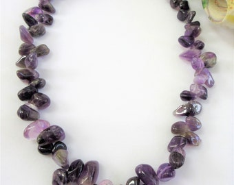 66 Polished rich purple amethyst stone necklace 18 inches, with silver lobster and 2 inch ext. chain, countless carats of gemstone