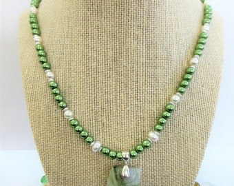 Strand of 6mm green glass and white pearls, silver spacers, green marbled agate pendant on sterling bail, fish clasp & ring,with earrings