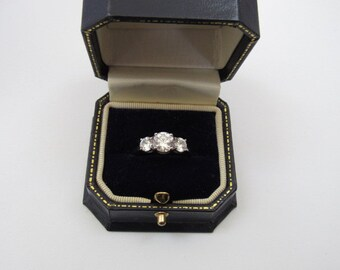 Triple Round Cut Cubic Zirconia Ring,Setting in Sterling Silver,.925 stamped Made in Viet Nam, Sparkling and excellent condition, never worn