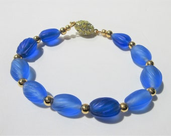 Blue Sea glass bead bracelet,matched beads of frosted glass w/14K gold spacer bead,magnetic closure,rhinestone magnetic clasp,gorgeous beads