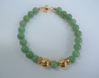 """Aventurine green bead bracelet, 8"""" of 21 8 mm polished beads, wired with 2 vintage 14K gold 10mm beads, and crystal accents, gold magnet"""