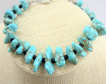Genuine Turquoise 22 half-inch nuggets bracelet,8-9 inch.black glass beads,Sterling silver toggle and multiple ring closure, Hand crafted