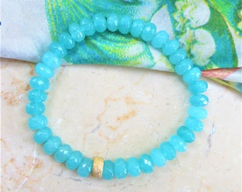 "Quartzite Stretch style bracelet; faceted aqua roundel beads; goldtone glittering roundel Average 7-1/4"" Fit, faceted beads measure 8mm"