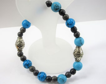 "Unisex Beaded Stretch Bracelet, 8 inch fitted, 8 mm faux turquoise stone ball beads, gray beads, with 2 "" silver oval tube beads"