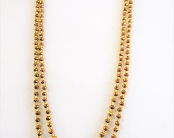 "Gold crystal and glass beads,20"" double strand strung with silk to a single strand and gold hook and loop closure,perfect pendant / enhancer"