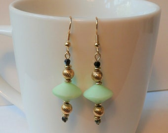 Earrings, Antique 14k gold plated beads, polished pale green artisan glass beads, black and green faceted crystals, gold plate earwires