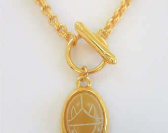 Beveled Gold stone Scarab Pendant,etched scarab oval in picture frame setting, Sturdy bright gold Double link toggle chain,enclosed cabachon