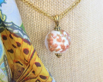 Lamp work Crystal Bead Pendant,30 in. Gold link Chain, Handcrafted white & copper glitter swirls, float inside a solid clear glass bead.