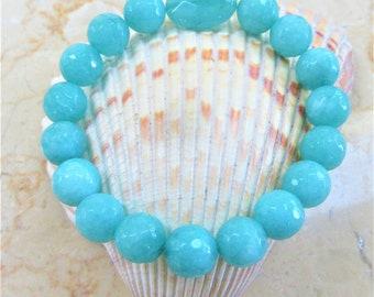 "Quartzite stretch style bracelet, large faceted aqua quartzite beads,oval faceted aqua station,Average 7-1/4"" Fit,faceted beads measure 10mm"