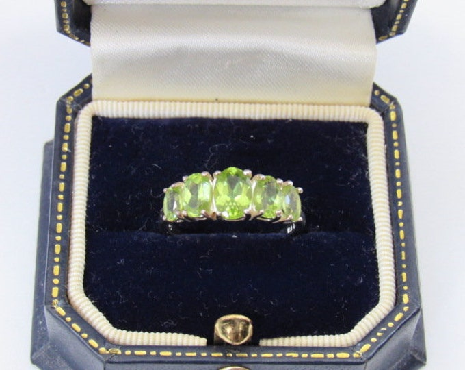 Featured listing image: Peridot 5 stone Ring August Birthstone, Gemstone Tapered Band Ring, Stamped .925, Perfect Condition, Size 7, Gorgeous green throughout