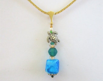 Sea glass pendant,Totem pole,stack of seaglass,pearl .925,silver turtle,gold wire, crystal beads,14K gold bail,blue glass nugget, gold chain