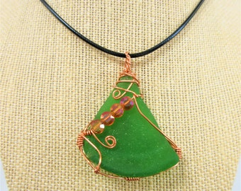 Genuine Sea Glass Pendant,green bottle glass wrap in copper wire,4 copper crystals, 2.5 inch pendant,18 in black cord,one of a kind seaglass