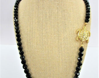 Faceted 8 mm Jet bead Necklace,Crystal Gold Turtle magnetic closure,25 inch,75 beads,sparkling 3 dimensional turtle magnet Versatile glamour