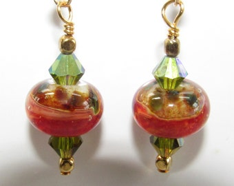 Lampwork green orange,Earrings,Glass Blown BeadsSwarovski green blue Aurora Crystal,Burnt orange Glass,14K Gold hook,Gold handwired earwire,