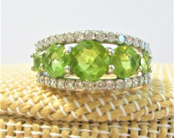 Judith Ripka Sterling 7 Gemstone Peridot Ring, 3+ carats of Peridot ,CZ stone set along both sides, Size 7,Vintage, Excellent Condition