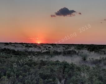 Sunset over field near Andrews Texas