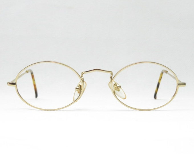 Vintage glasses / small oval eyewear frame from the 80s / reading glasses / gold metal frame / fashion accessory / gift for her /trend