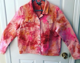 Tie dye denim jacket in pinks, oranges and reds