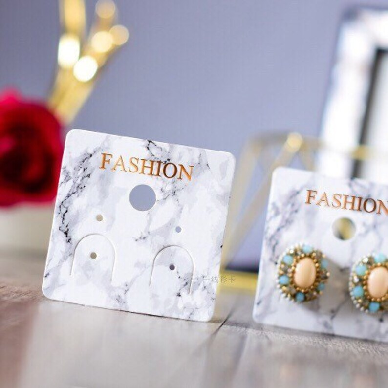 Earrings-stud w white blue marble stones in rose gold colored setting