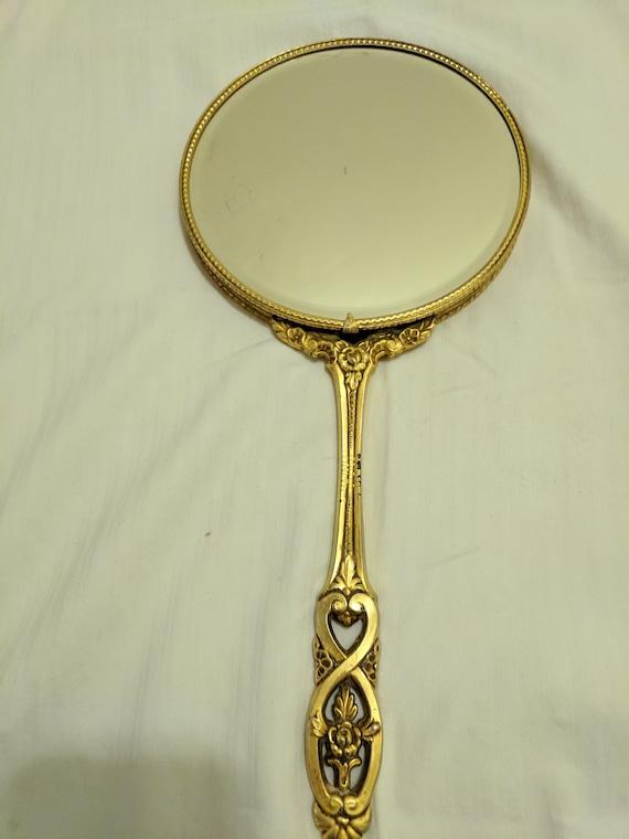 ornate hand mirror. image 0 ornate hand mirror