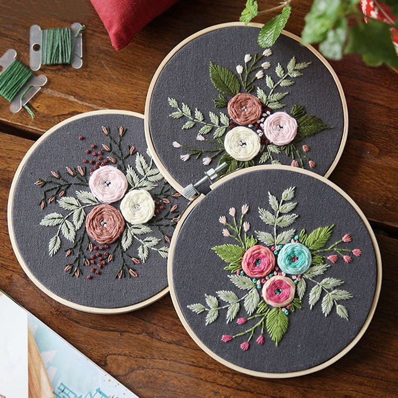 three floral bouquets in three embroidery hoops