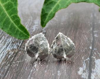 Silver heart leaf stud earrings. Handmade fine silver violet leaf studs with sterling silver earring posts & butterflies. Tiny leaf earrings
