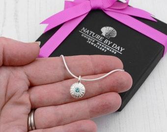 Silver sea urchin and birthstone necklace. Amethyst, Aquamarine, Sapphire or a diamond set in a silver sea urchin necklace.