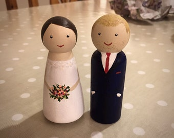 Personalised peg doll bride and groom wedding cake toppers