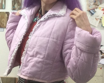 Upcycled padded short jacket in soft lilac/pink colour. Surprise sequin rainbow appliqued on the back!