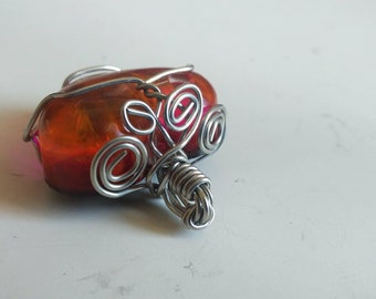 Amber resin pendant with silver wire wrapping