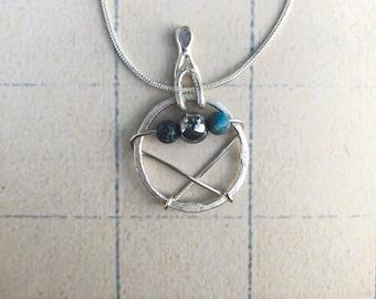 Mixed metals pendant necklace