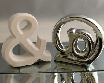 Ampersand and @ symbol cermaic letters