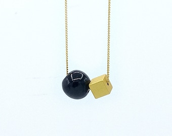 Graphic design necklace handcrafted ceramic button and jewelry wire