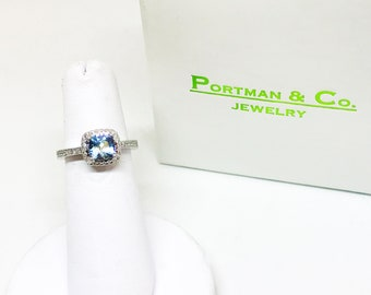 14 Karat white gold blue topaz and diamond halo ring
