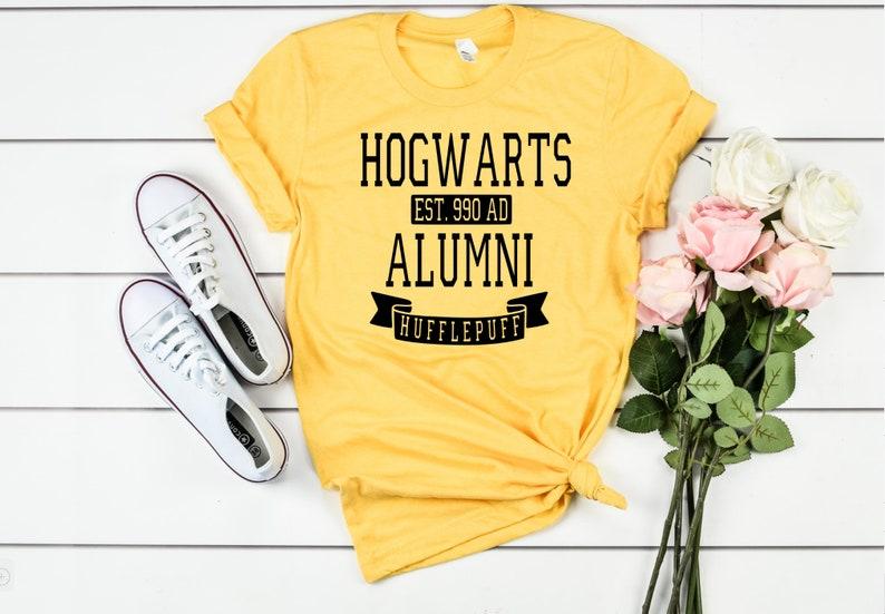 Yellow Hogwarts alumni Hufflepuff shirt.