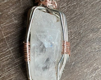Quartz wrapped in silver and rose gold