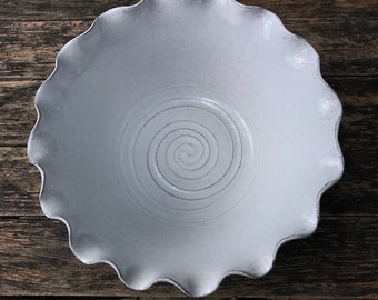 Large handmade terracotta fluted bowl.