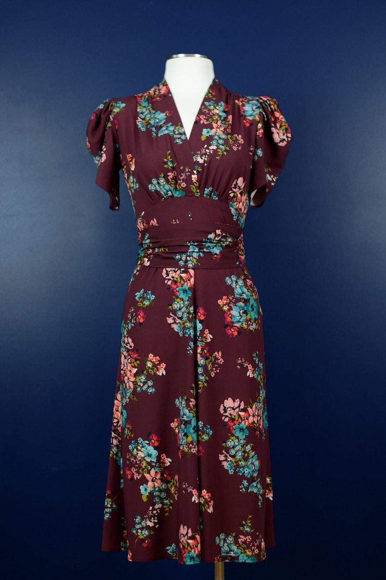 Vintage Style Dresses | Vintage Inspired Dresses Vintage 1930s style dress in dark red with pink and blue flowers sizes US 0-24 $195.00 AT vintagedancer.com