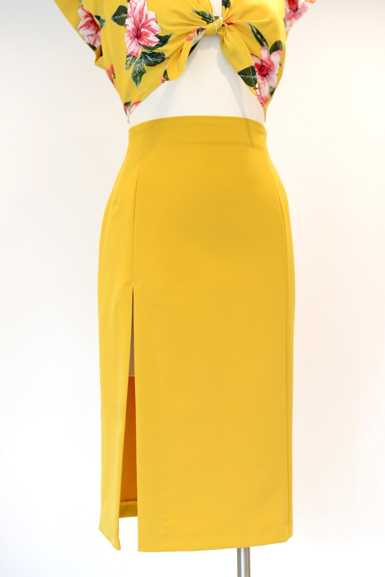 1950s Swing Skirt, Poodle Skirt, Pencil Skirts High-waist pencil skirt with a front slit in petrol blue sizes US 0 to 22 $65.00 AT vintagedancer.com