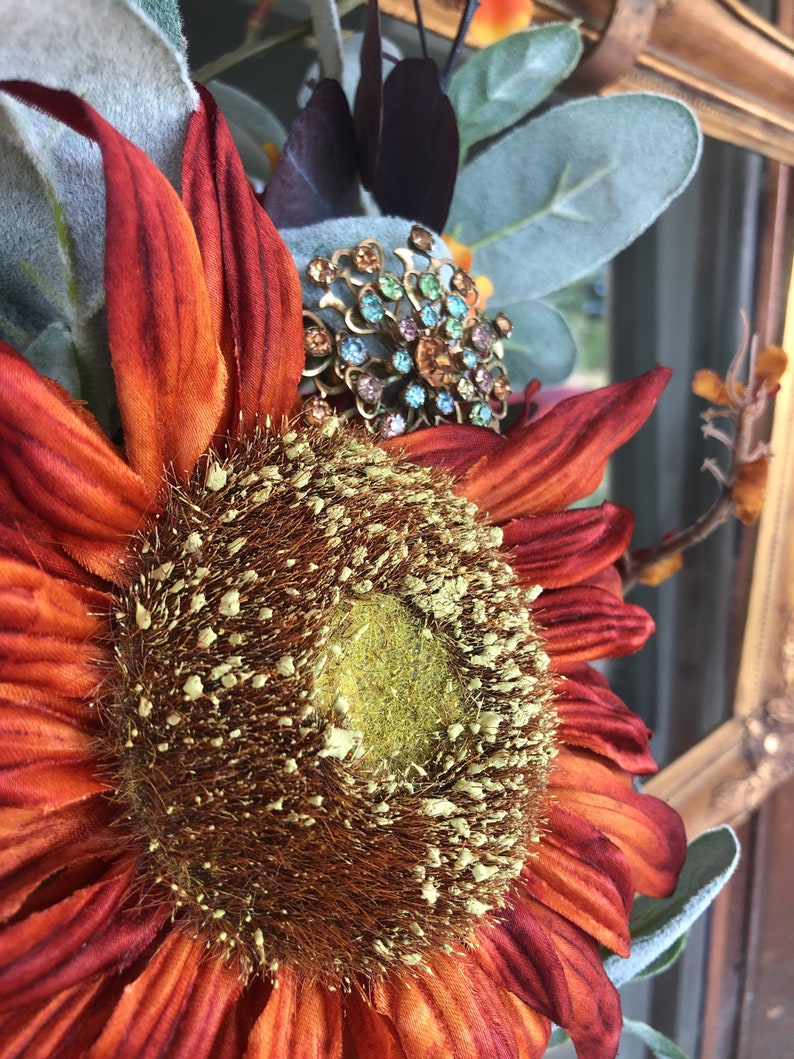 This broach has so many beautiful jewel tones Vintage Broach It looks beautiful on denim They are set in a beautiful vintage brass