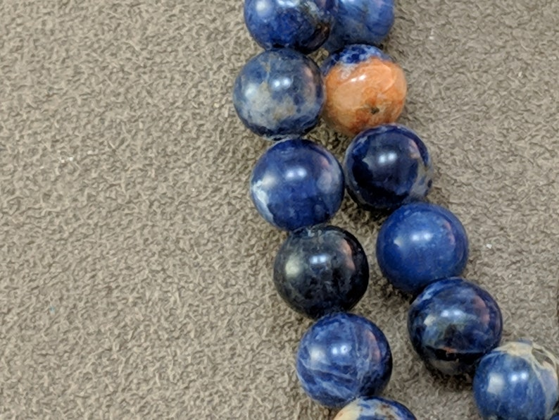 16 strand 2136  Red Line Sodalite 7mm round beads smooth blue and orange