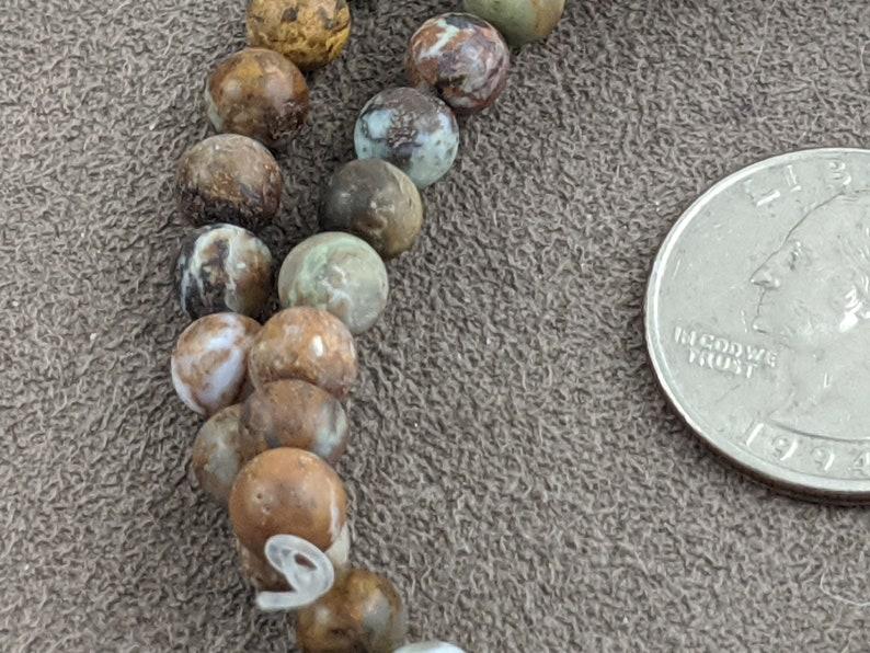 from Dakota Stone  DAK955 6mm MATTE African Green Opal Round 15.5 approx 64 beads