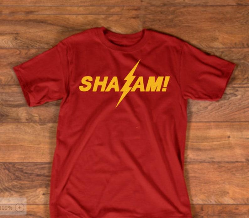 47bbac98635 Shazam Shirt Yellow Lightning DC inspire shirt Shazam Logo