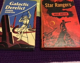 2 Andre Norton hardbacks from the 1950s old library bindings